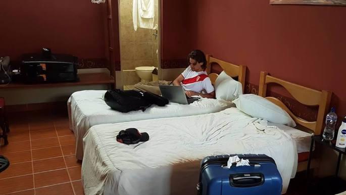 me blogging on bed edited.jpg